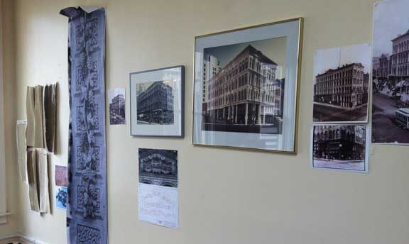 A collection of historical photos of the Iron Block Building, paint swatches for the exterior, and other details.